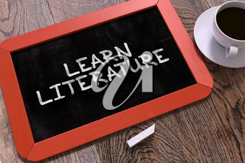 Hand Drawn Learn Literature Concept  on Small Red Chalkboard. Business Background. Top View. 3d Render.