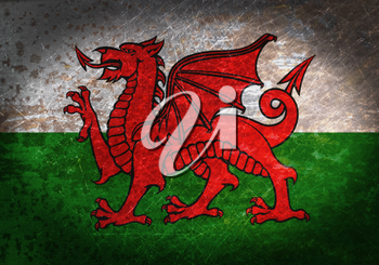 Old rusty metal sign with a flag - Wales
