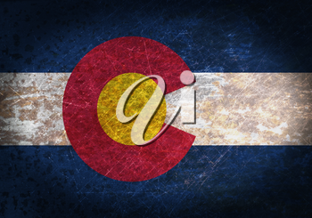 Old rusty metal sign with a flag - Colorado