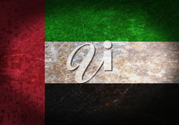 Old rusty metal sign with a flag - UAE