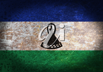 Old rusty metal sign with a flag - Lesotho