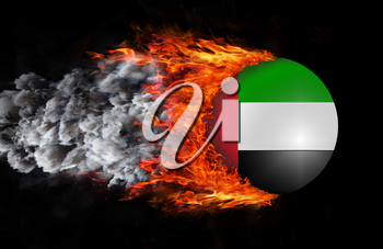Concept of speed - Flag with a trail of fire and smoke - United Arab Emirates
