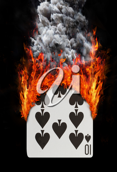 Playing card with fire and smoke, isolated on white - Ten of spades