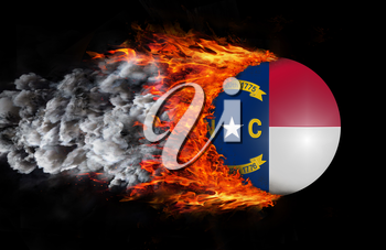 Concept of speed - Flag with a trail of fire and smoke - North Carolina