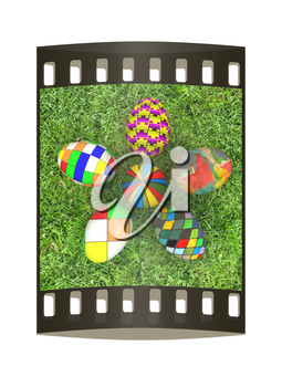 Flower of Easter eggs on the grass. The film strip with place for your text