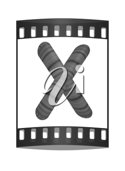 Wooden Alphabet. Letter X on a white background. The film strip
