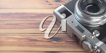 Retro vintage camera on wood table background. Space for text. 3d illustration