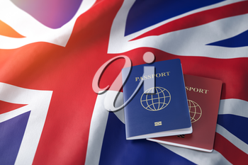 Passports on the flag of the Australia. Getting a visa to Australia ,  travel, naturalization and immigration concept. 3d illustration