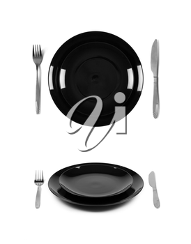 Two black plates with fork and knife. 2 different views. Isolated on white background. Two different view angles. Graphic design element for poster, menu, restaurant or cafe flyer.