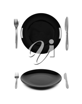 Black plate with fork and knife. 2 different views. Isolated on white background. Two different view angles. Graphic design element for poster, menu, restaurant or cafe flyer.