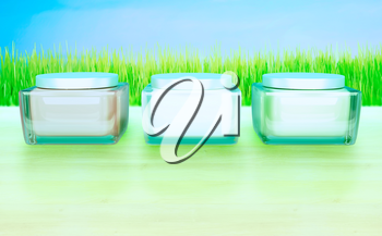 Three Flasks with cosmetic cream on a blue background. Daily, beauty care cosmetic. Face creams. Skin care.