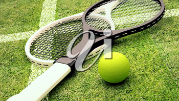 Tennis rackets and ball are located on grass court.