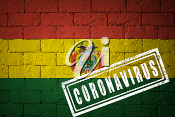 Flag of the Bolivia with original proportions. stamped of Coronavirus. brick wall texture. Corona virus concept. On the verge of a COVID-19 or 2019-nCoV Pandemic.