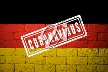 Flag of the Germany with original proportions. stamped of Coronavirus. brick wall texture. Corona virus concept. On the verge of a COVID-19 or 2019-nCoV Pandemic.