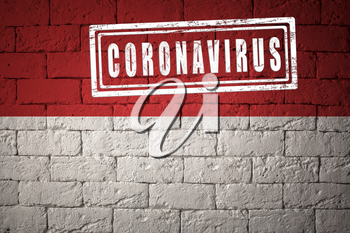 Flag of the Monaco with original proportions. stamped of Coronavirus. brick wall texture. Corona virus concept. On the verge of a COVID-19 or 2019-nCoV Pandemic.