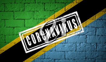 Flag of the Tanzania with original proportions. stamped of Coronavirus. brick wall texture. Corona virus concept. On the verge of a COVID-19 or 2019-nCoV Pandemic.