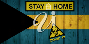 Flag of the Bahamas in original proportions. Quarantine and isolation - Stay at home. flag with biohazard symbol and inscription COVID-19.