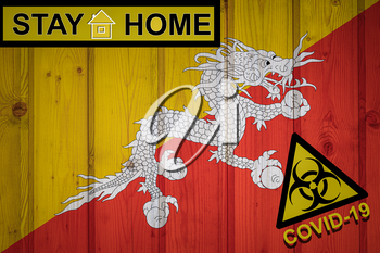 Flag of the Bhutan in original proportions. Quarantine and isolation - Stay at home. flag with biohazard symbol and inscription COVID-19.