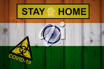 Flag of the India in original proportions. Quarantine and isolation - Stay at home. flag with biohazard symbol and inscription COVID-19.