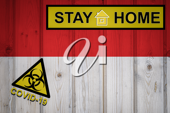 Flag of the Indonesia in original proportions. Quarantine and isolation - Stay at home. flag with biohazard symbol and inscription COVID-19.