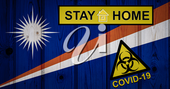 Flag of the Marshall Islands i in original proportions. Quarantine and isolation - Stay at home. flag with biohazard symbol and inscription COVID-19.