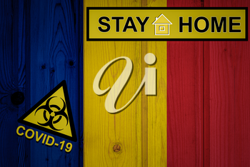 Flag of the Romania in original proportions. Quarantine and isolation - Stay at home. flag with biohazard symbol and inscription COVID-19.