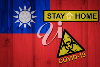Flag of the Taiwan in original proportions. Quarantine and isolation - Stay at home. flag with biohazard symbol and inscription COVID-19.