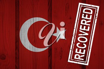 flag of Turkey that survived or recovered from the infections of corona virus epidemic or coronavirus. Grunge flag with stamp Recovered
