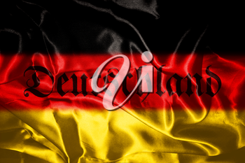 German flag blowing in the wind With Germany Written On It