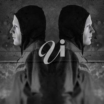 Twin figures against grungy wall background. 3d illustration and photo composite.